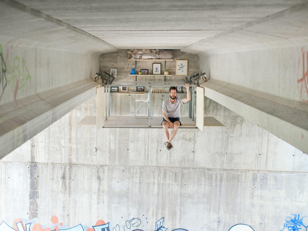Designer creates daredevil secret studio under a bridge