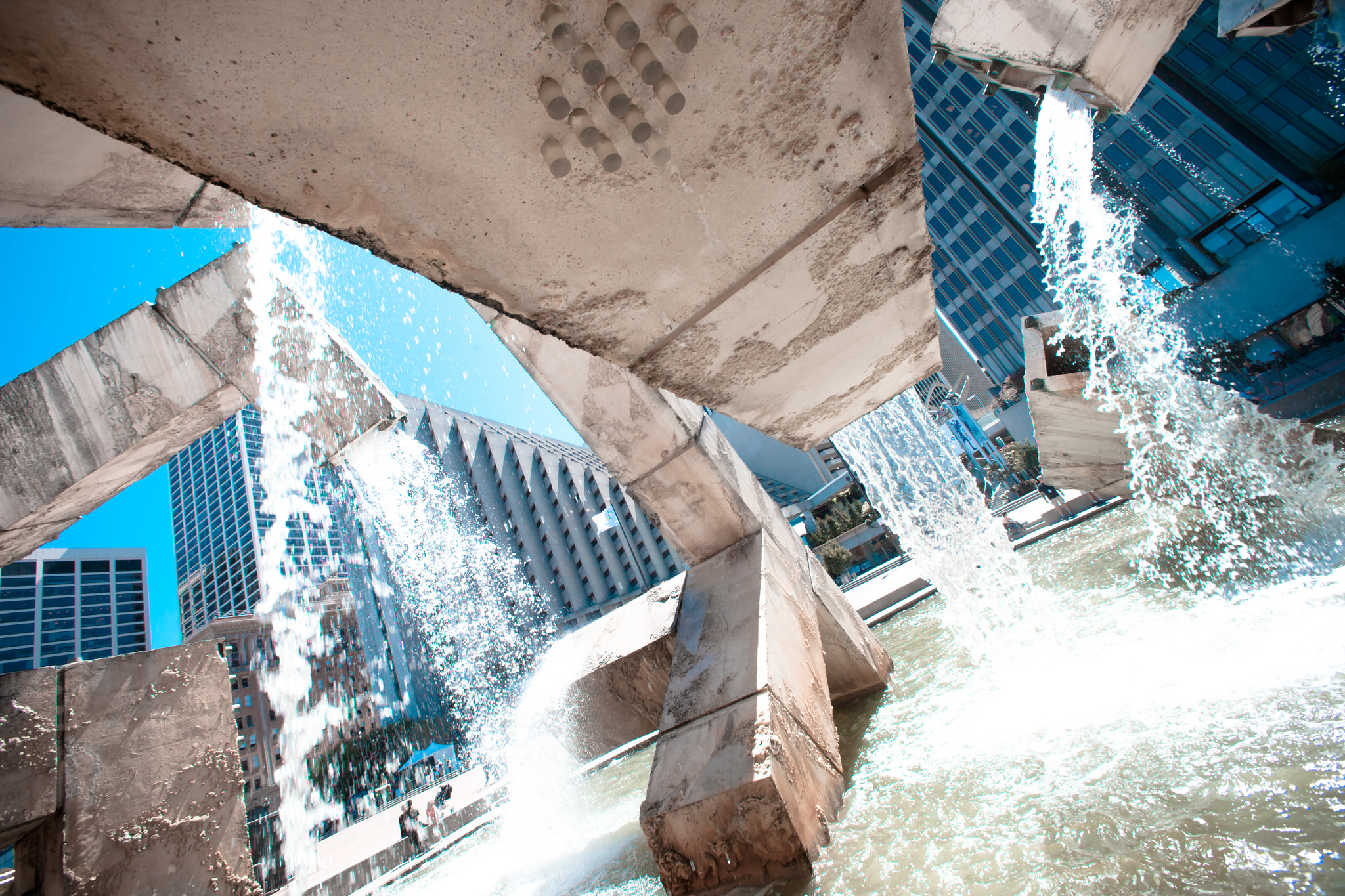 Image of fountain with water running out of its square spigots.