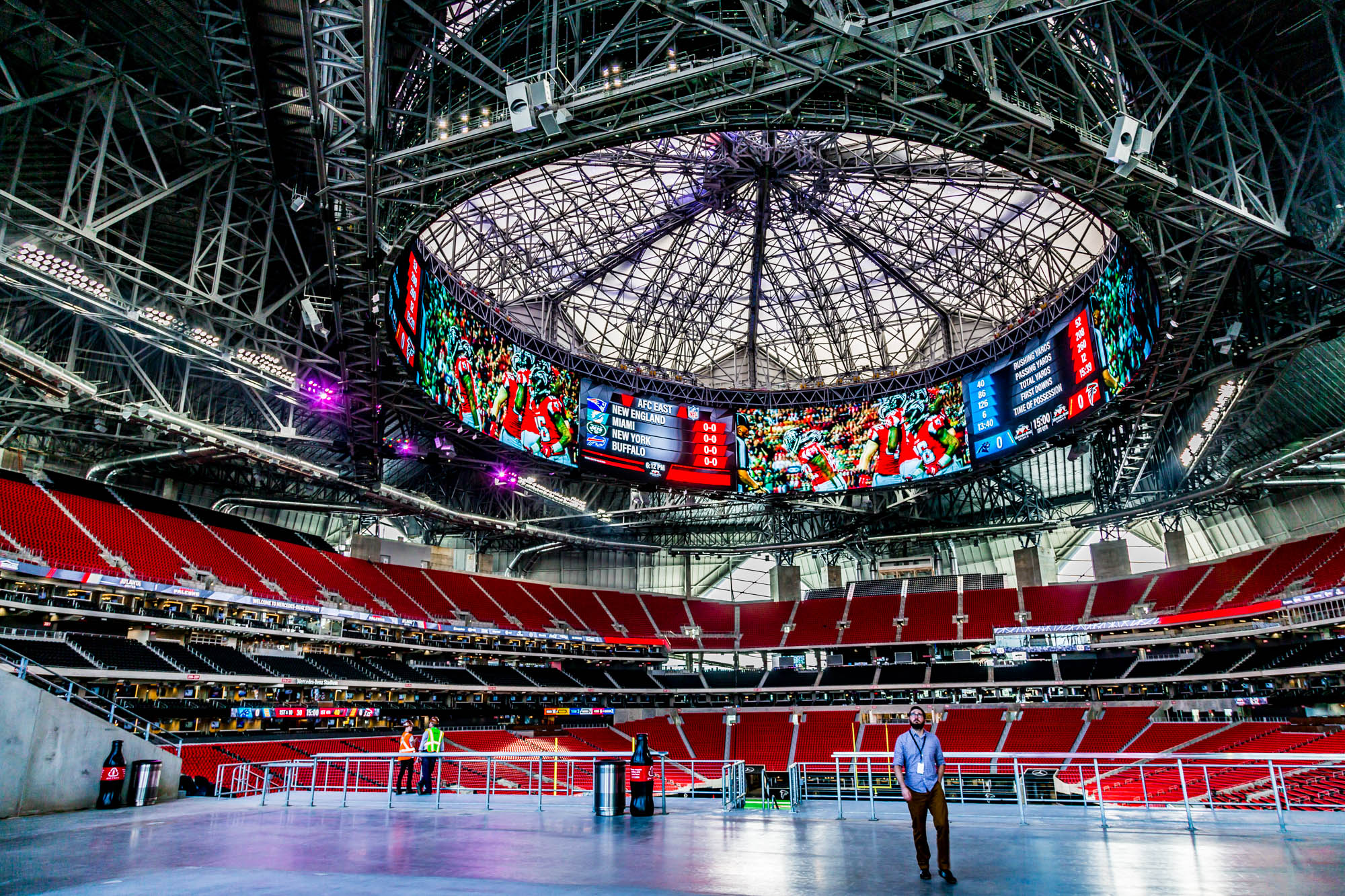 Looking up at the retractable roof and halo video board inside Mercedes-Benz Stadium.
