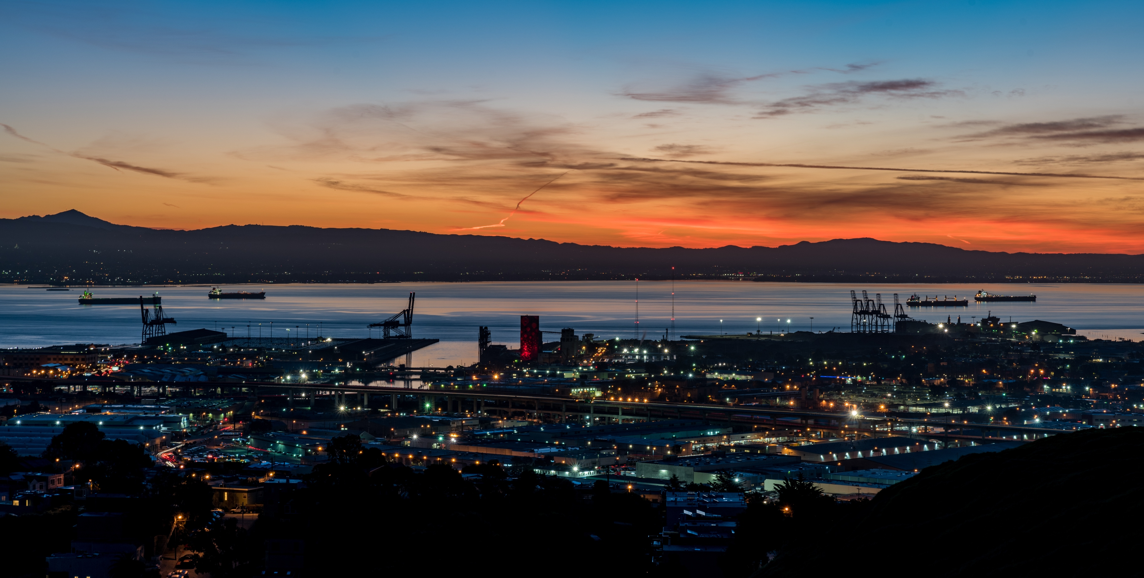 A night photo of the Bayview and the bay beyond it.