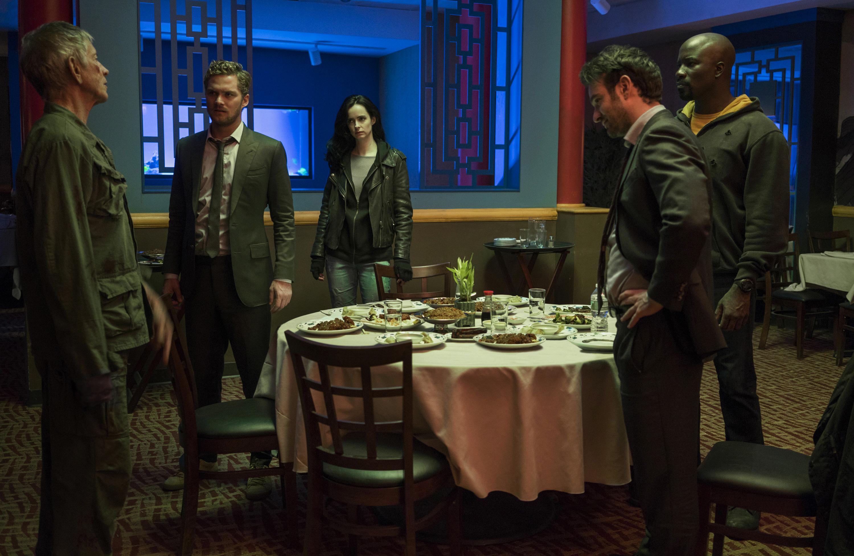 Stick, Danny Rand, Jessica Jones, Matt Murdock and Luke Cage in The Defenders.
