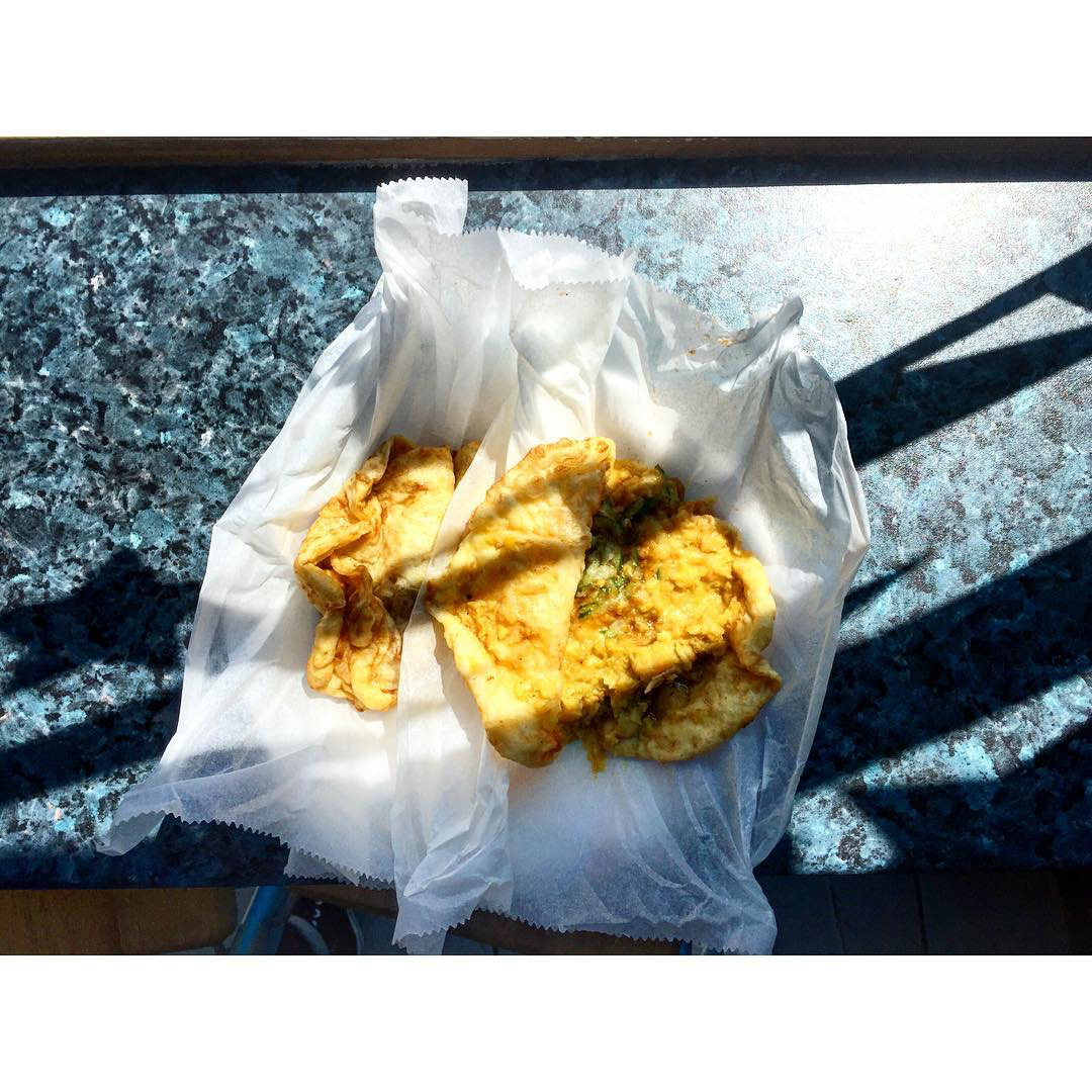 The best Trinidadian roti and Caribbean food in London: Fried baras filled with chickpea curry from Roti Joupa on Clapham Common, London