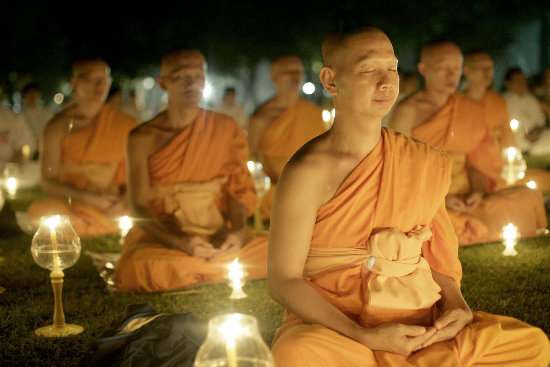 Buddhist monks meditating