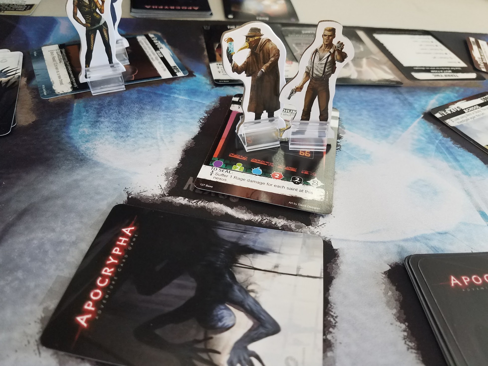 Apocrypha is a card game and tabletop RPG in one box (correction)