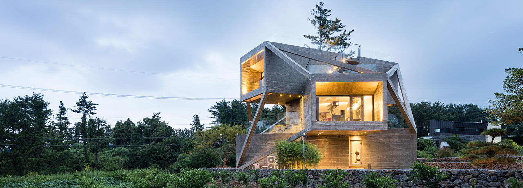 This wacky concrete house is made of angled volumes