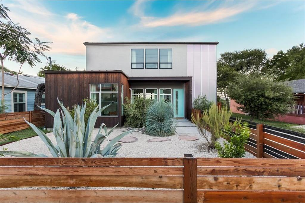 Photo of two-story stucco and wood contemporary