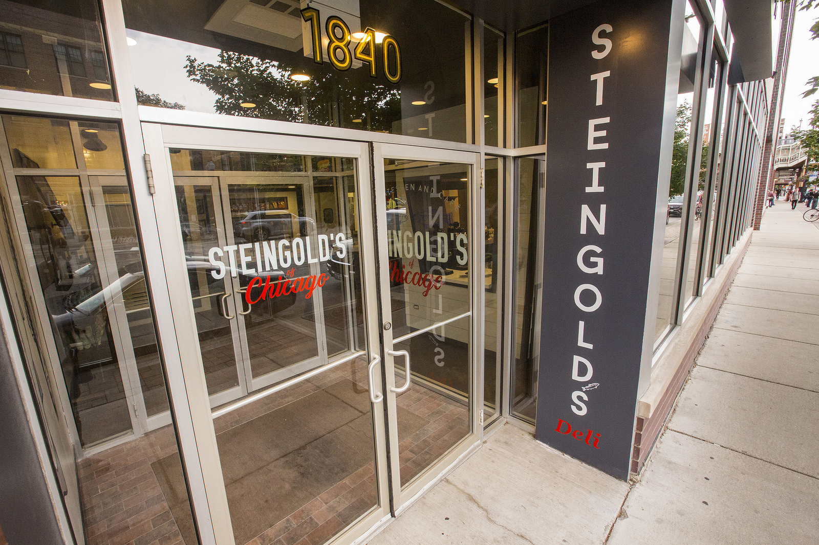 """The entrance to a building, door reads """"Steingold's of Chicago"""""""