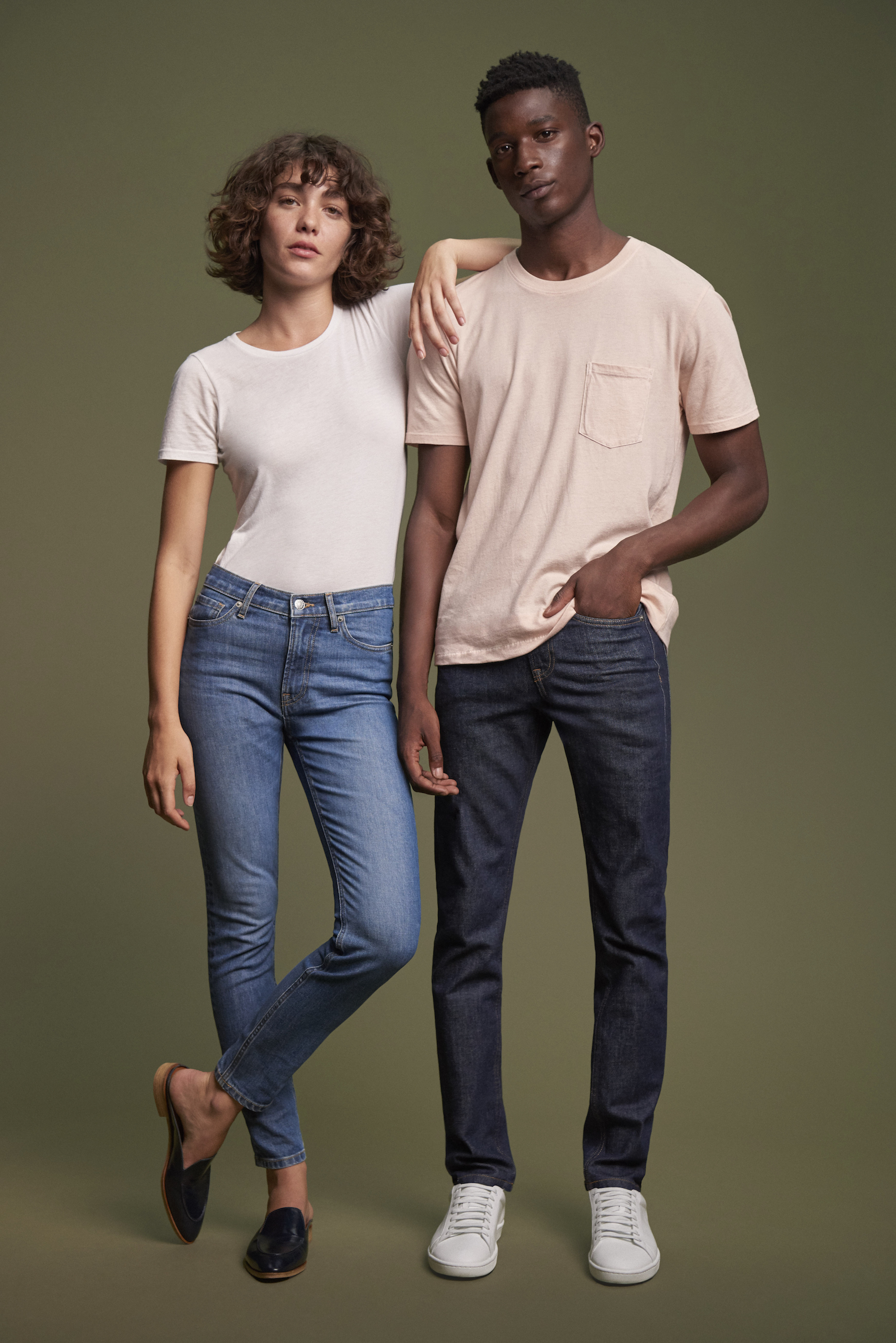 Two models wearing jeans and a T-shirt