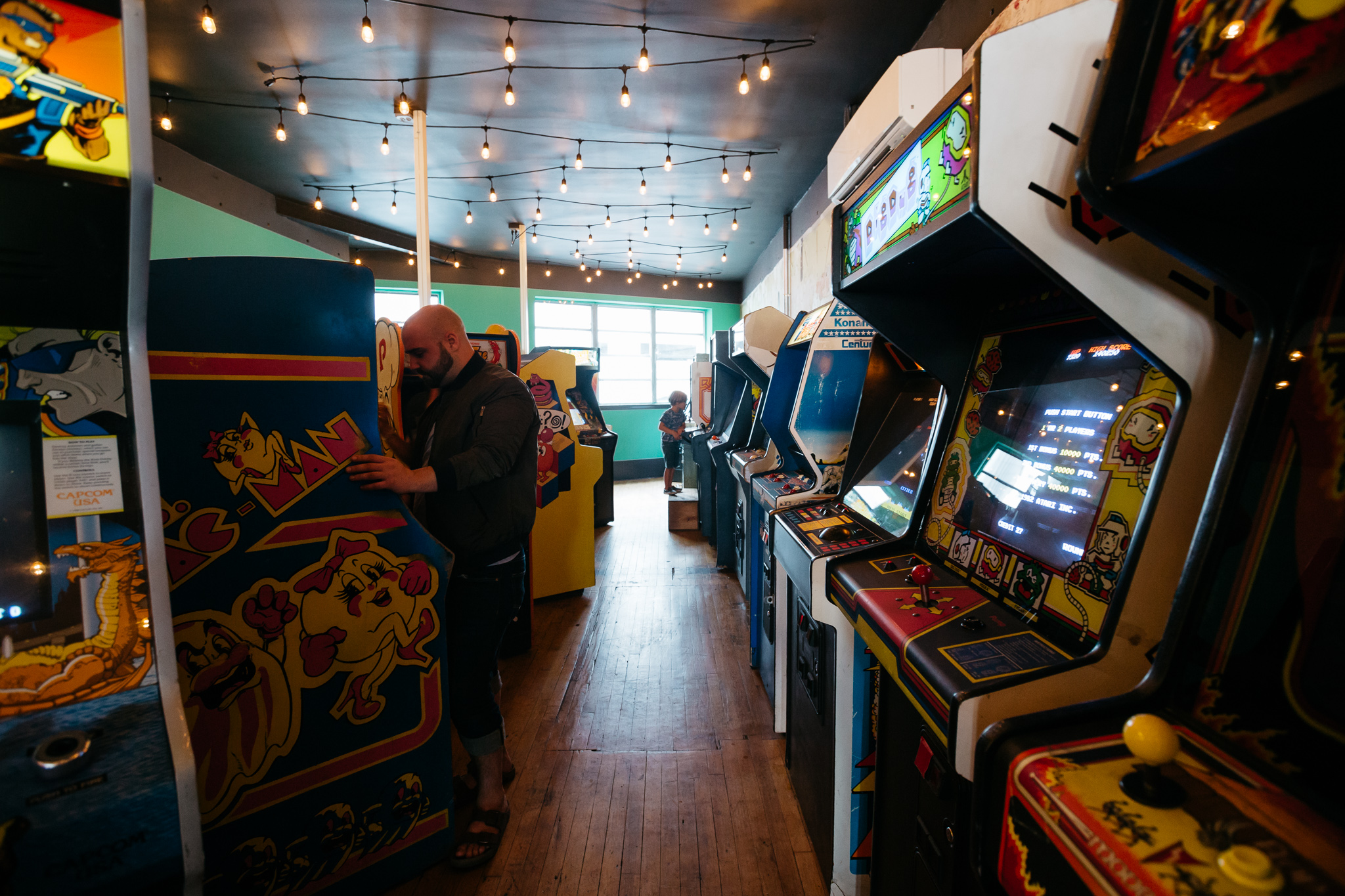 Game consoles line the walls inside Pop Pizza.