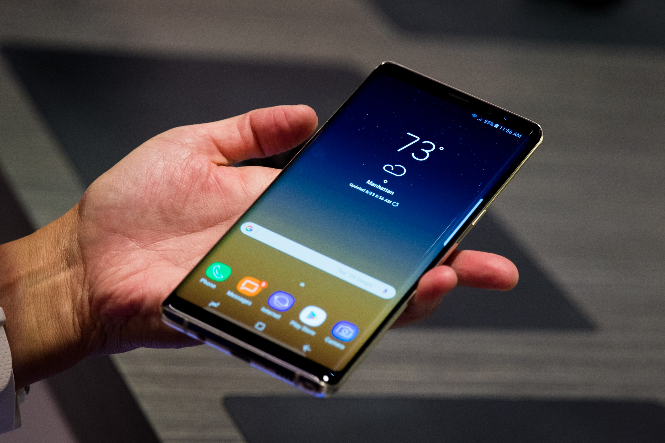 The new Samsung Galaxy Note 8 smartphone covers most of the hand holding it.