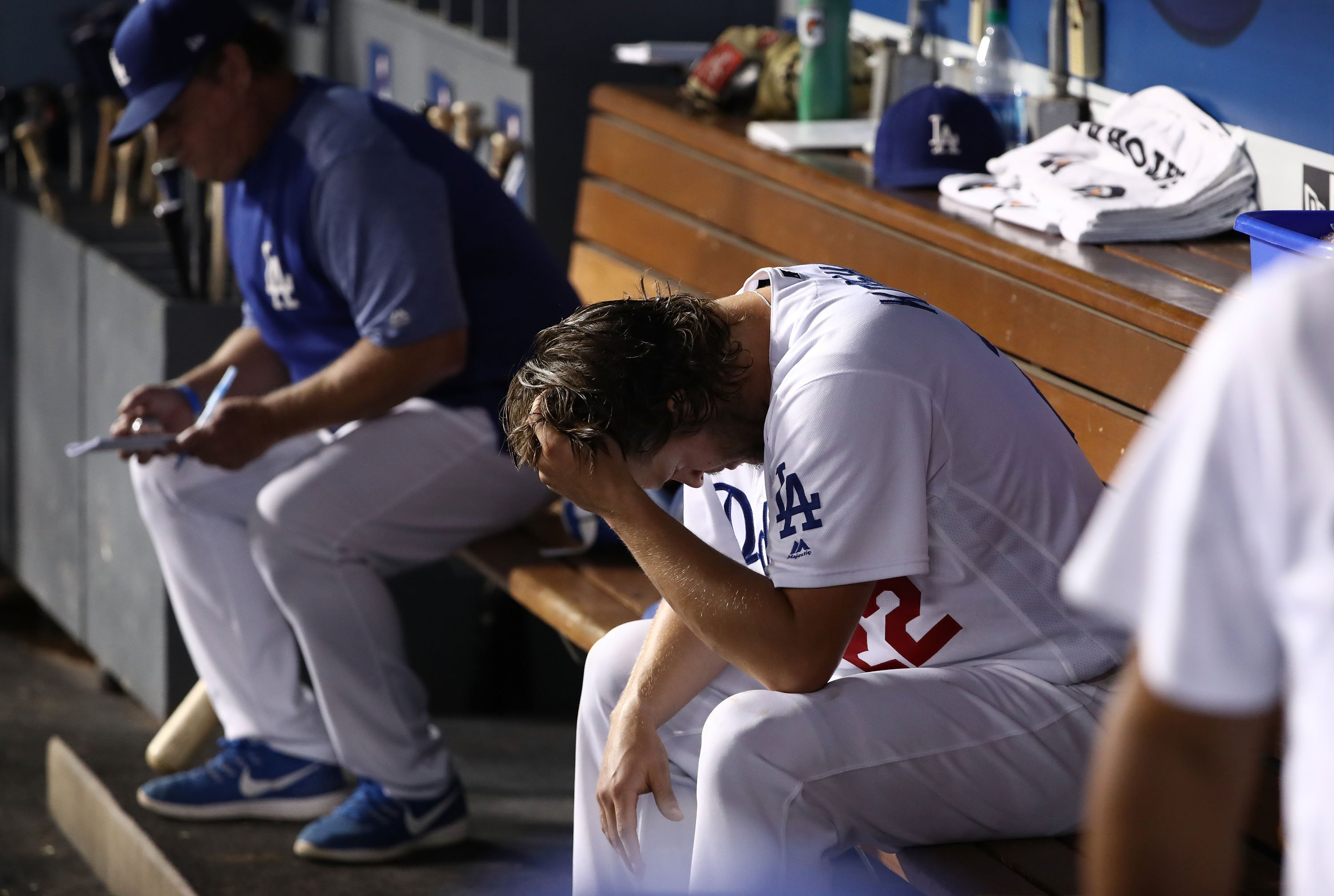 Clayton Kershaw holds his head in the dugout
