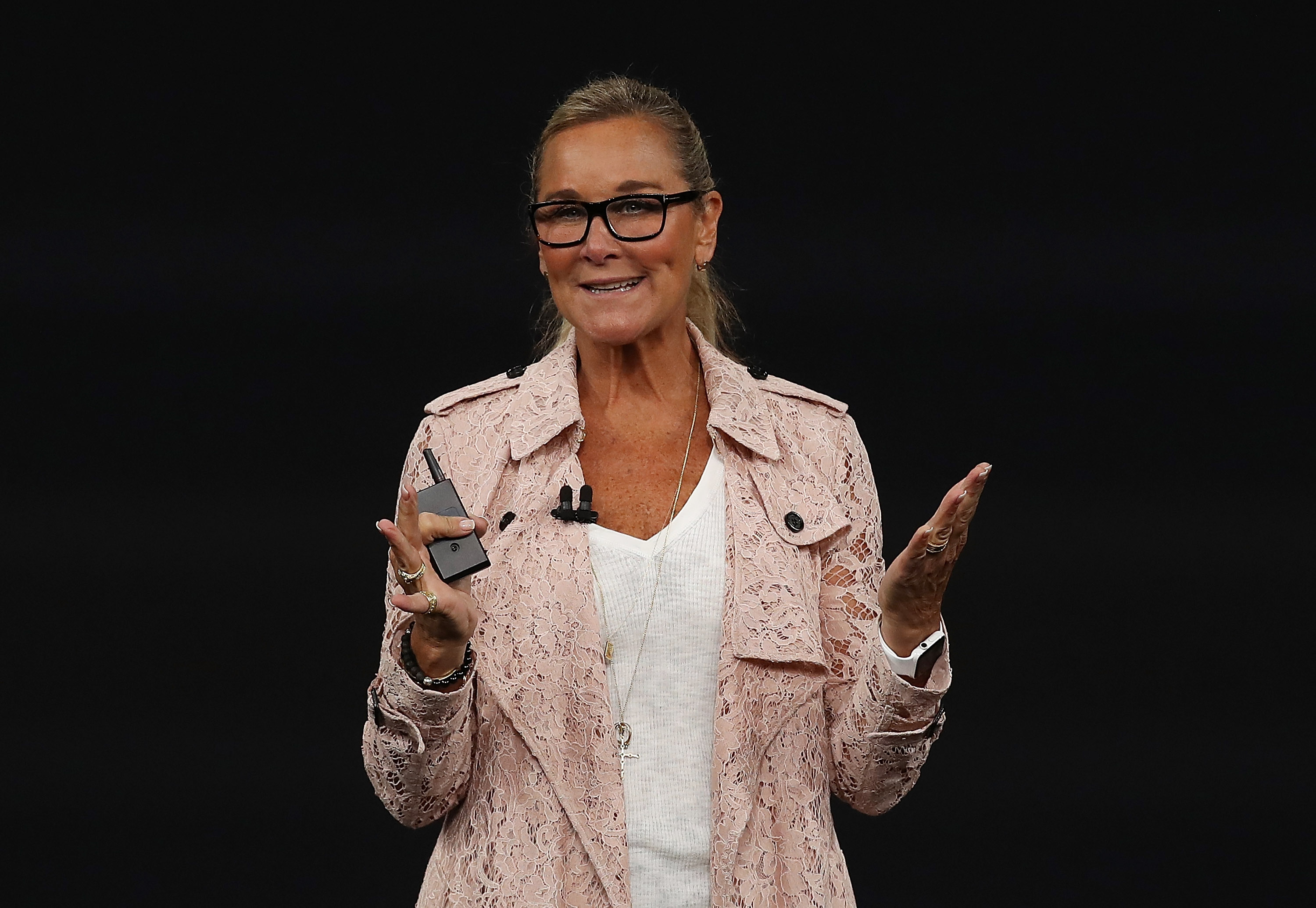 Apple senior vice president of retail Angela Ahrendts in a lacy pink Burberry trenchcoat.