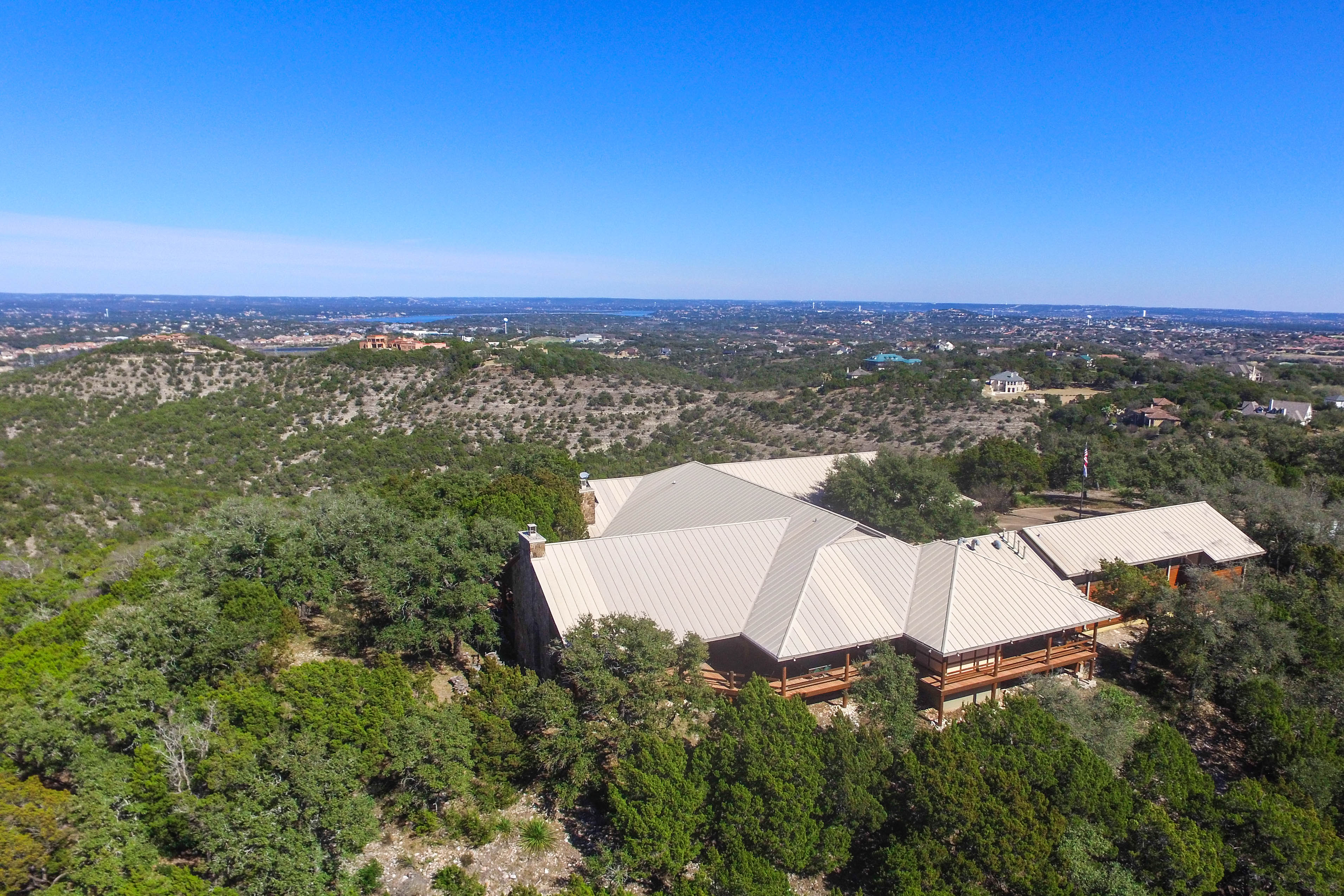 Aerial view of large ranch house and ranch