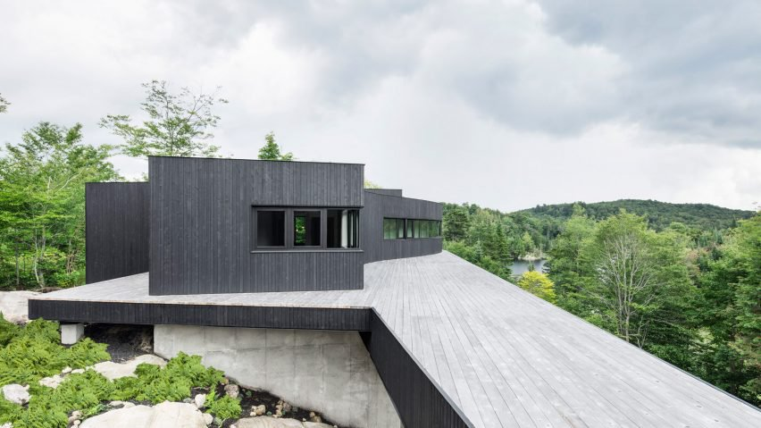 Solar-powered home features sweeping deck, mountain views