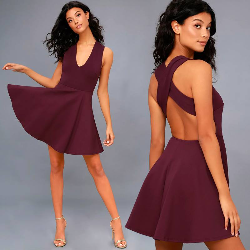 A model in a red Lulus dress