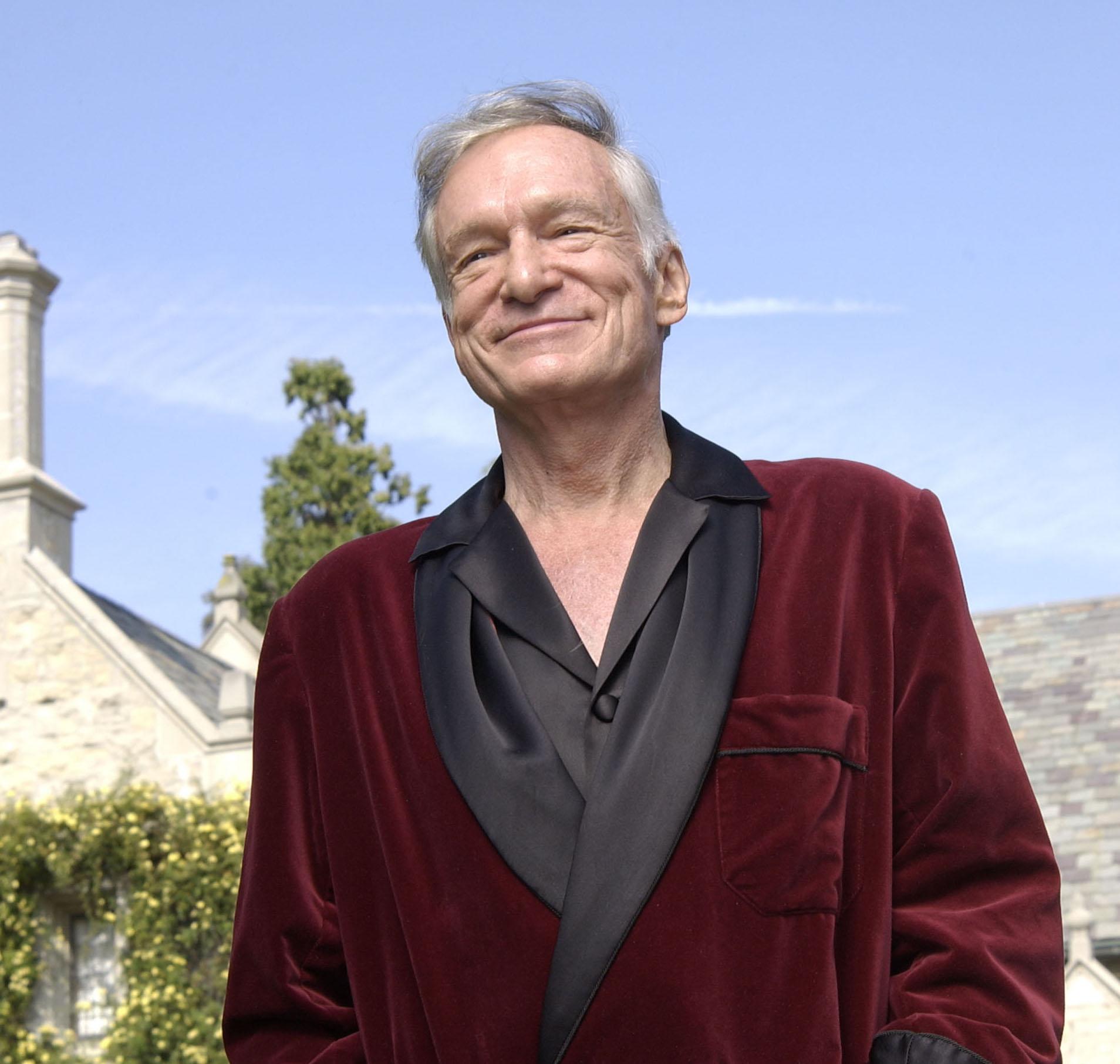 Hugh Hefner in front of Playboy Mansion