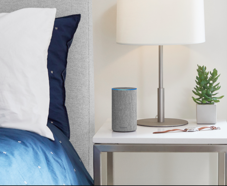 The new $100 Amazon Echo in grey, on a nightstand
