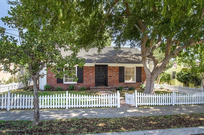 View of house with white picket fence