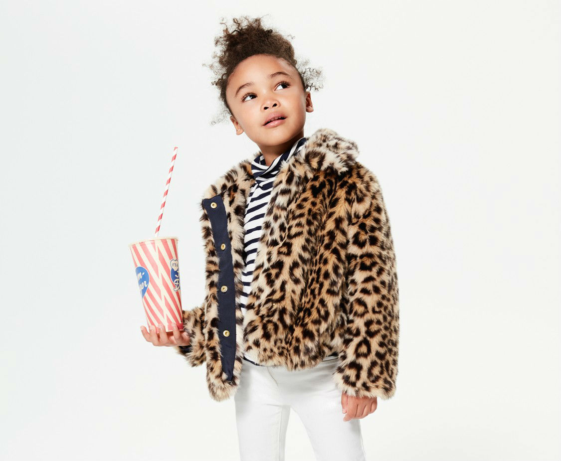 A kid in a leopart print jacket