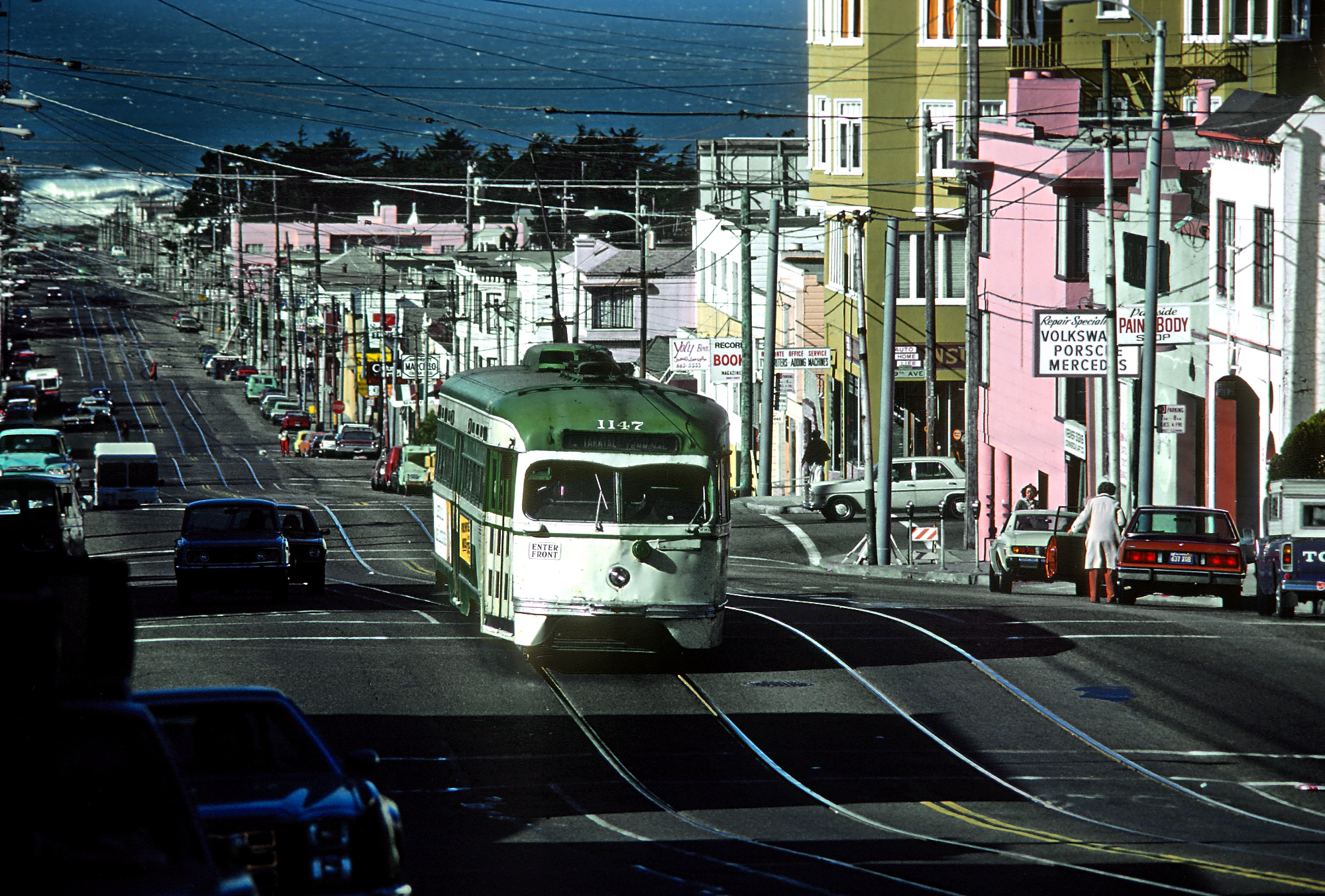 Taraval Street in 1980, with an old streetcar and waves breaking on Ocean Beach at the end of the lane.