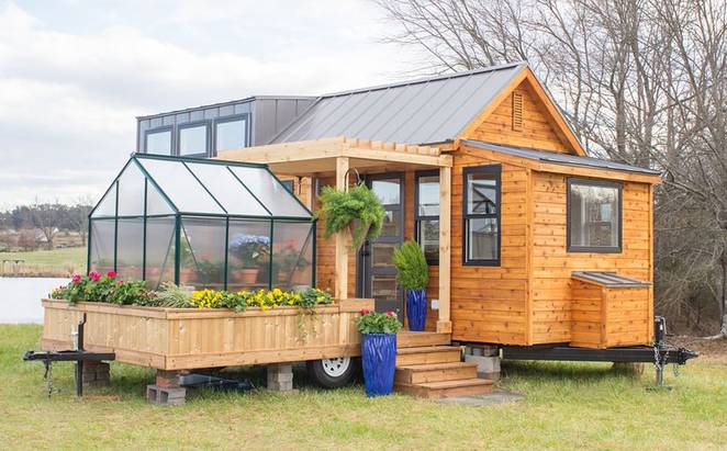 Charming tiny house comes with a greenhouse and porch