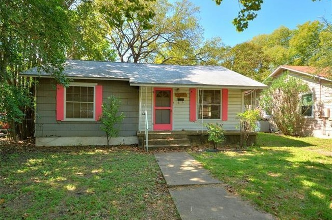 Small green bungalow wth red shutters