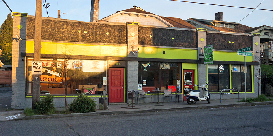 The exterior of Cafe Racer, with lime green accents