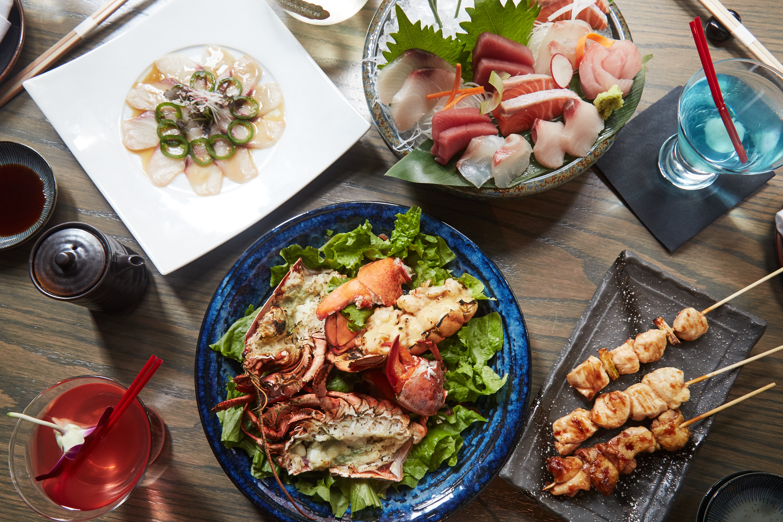 Yellowtail carpaccio, sashimi, grilled lobster, and assorted yakitori at Wokuni