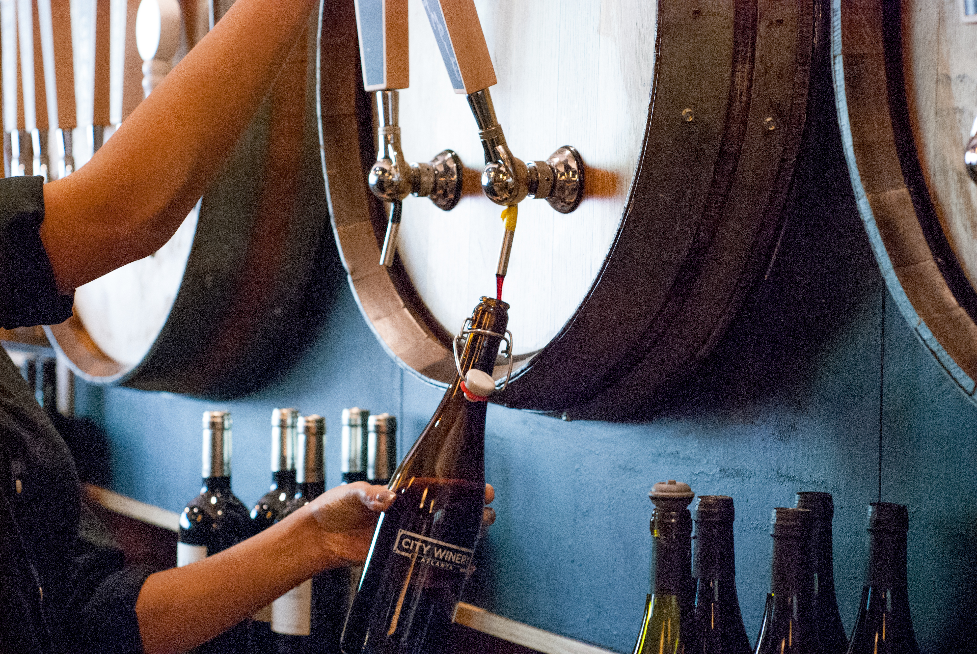 A wine growler being filled at City Winery