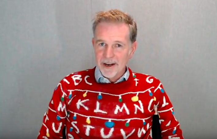 """Photo of Netflix CEO Reed Hastings on the Q3 earnings call wearing a """"Stranger Things"""" Christmas sweater from Target"""