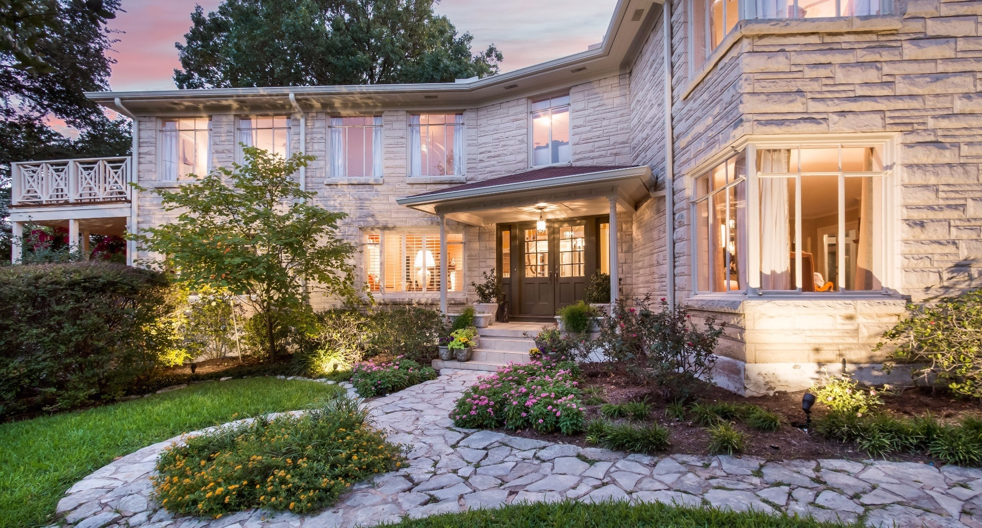 Large white stone two story house