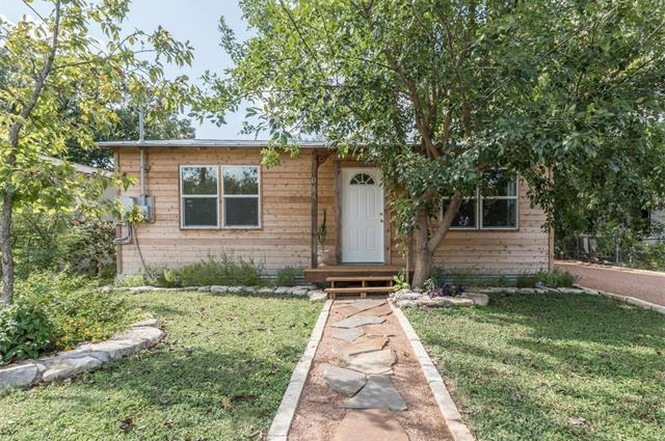 Small 1950 home with reclaimed wood siding