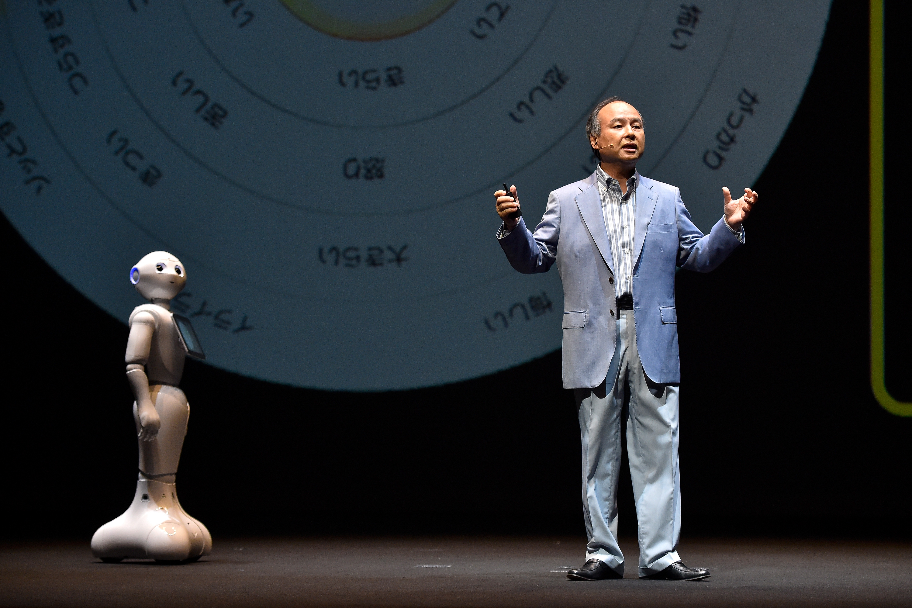 SoftBank CEO Masayoshi Son onstage with the Pepper robot