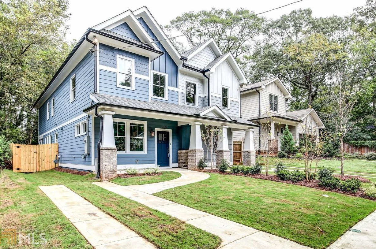 A blue-gray Craftsman duplex for sale in Edgewood.