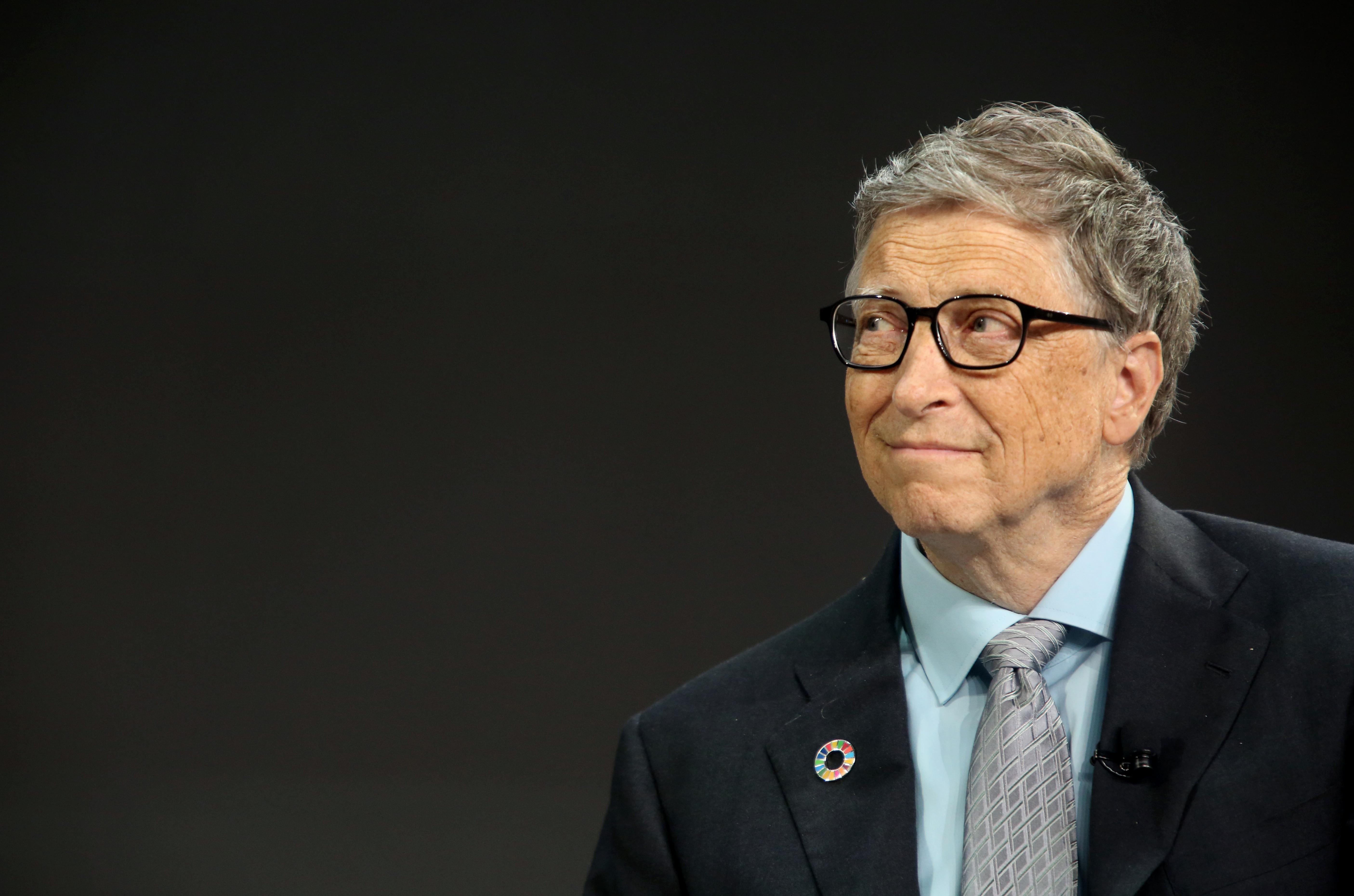Bill Gates listens to former U.S. President Barack Obama at a Gates Foundation event.