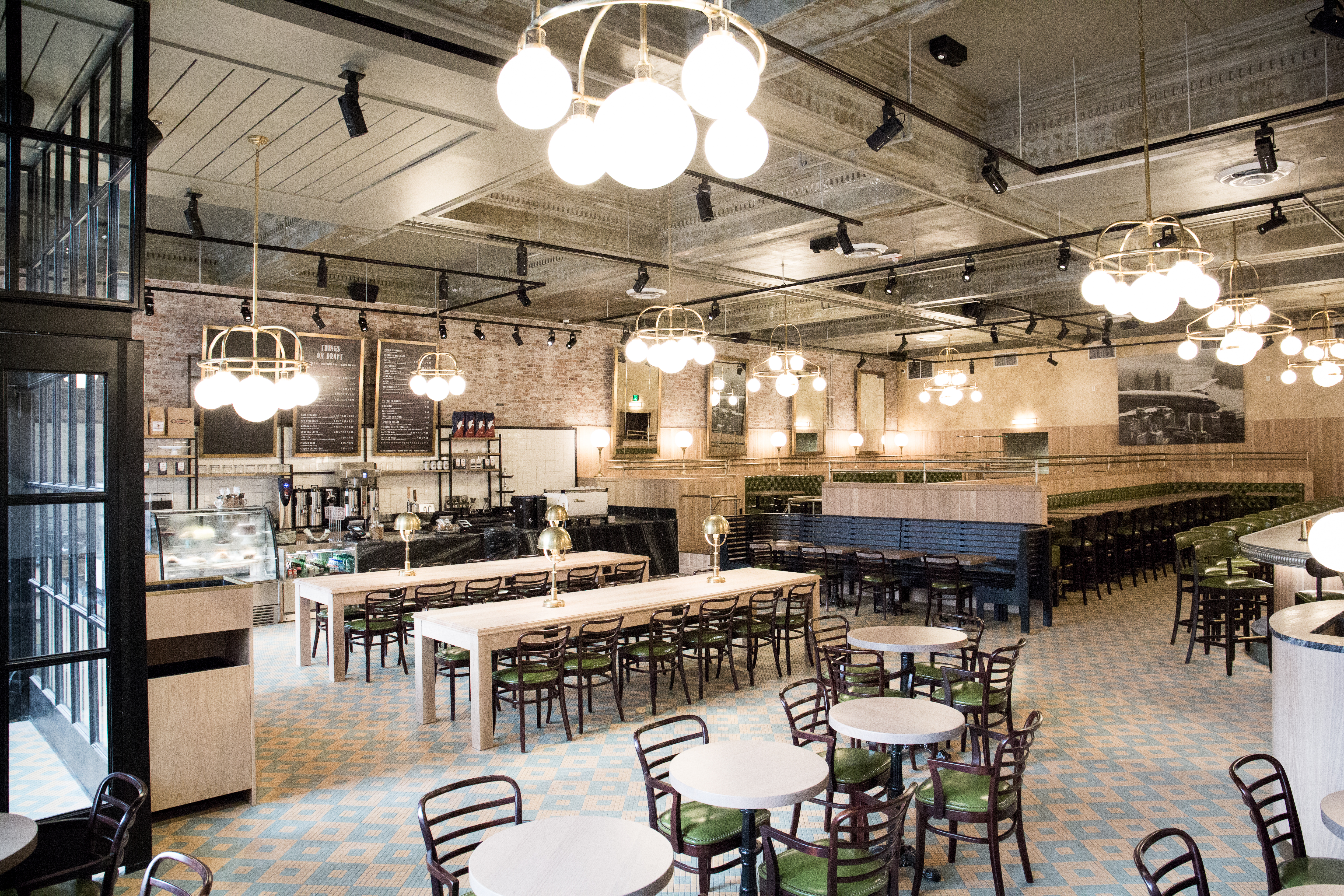 Cafe interior, featuring light tiling and green accents