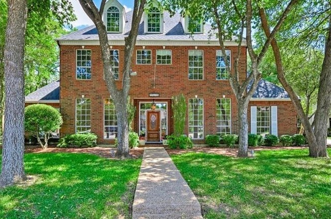 Large two-story brick traditional home