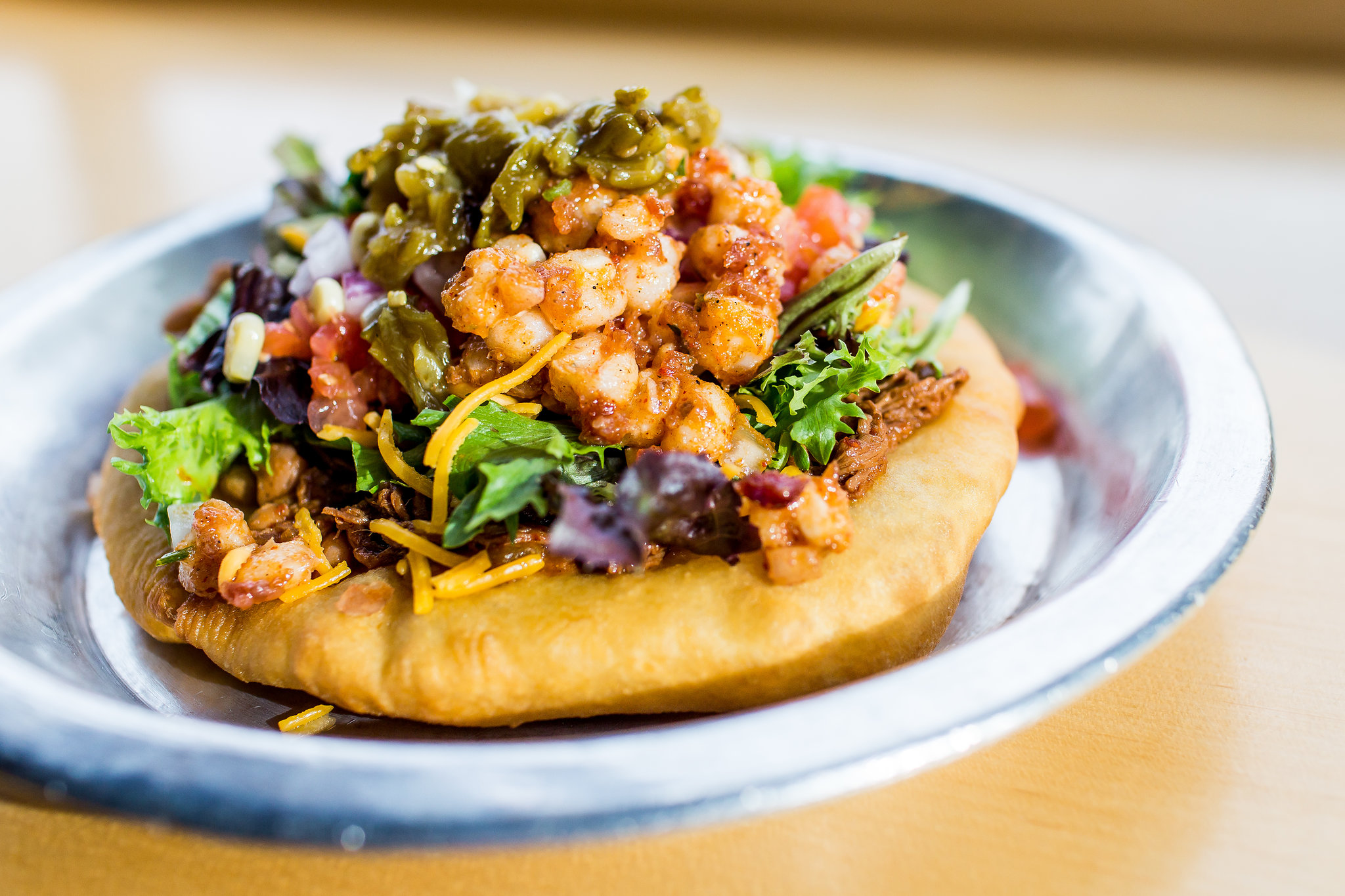 American Indian frybread topped with bison, cheese, and vegetables