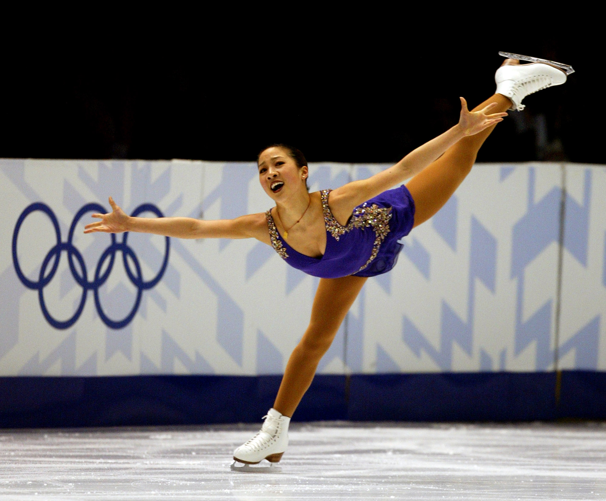 Michelle Kwan competing in the Ladies' Short Program at the 2002 Olympic Games.