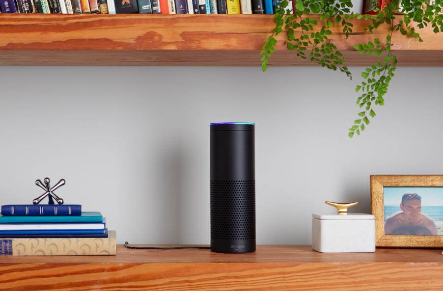 The black Amazon Echo speaker on a shelf