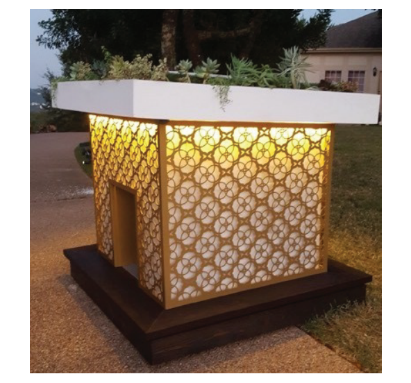 A glowing white doghouse clad in gold-colored, patterned siding