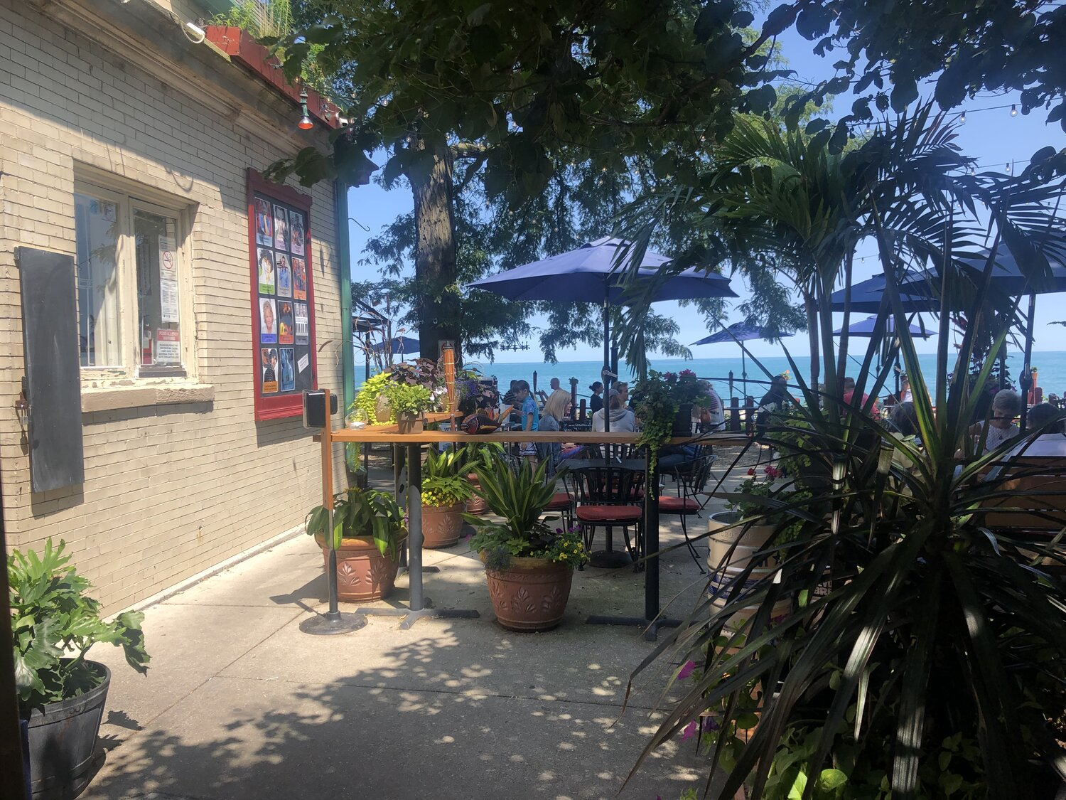 a dining patio with Lake Michigan in the background