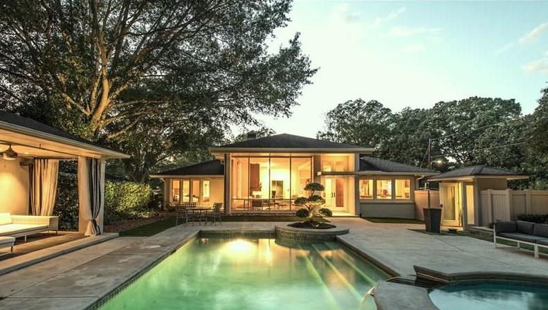 The backyard of a stunner midcentury house for sale in Atlanta's LaVista Park.