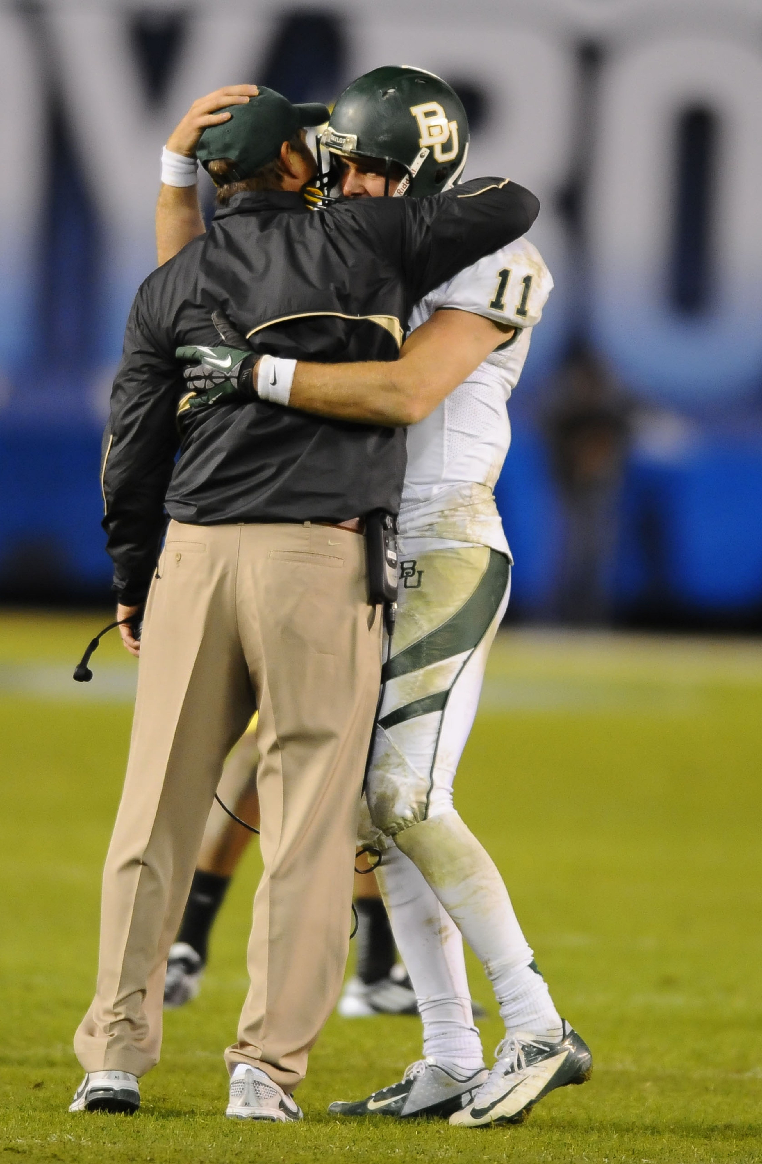 Nick Florence and Art Briles embrace. The entire Holiday Bowl experience was like one giant love fest.