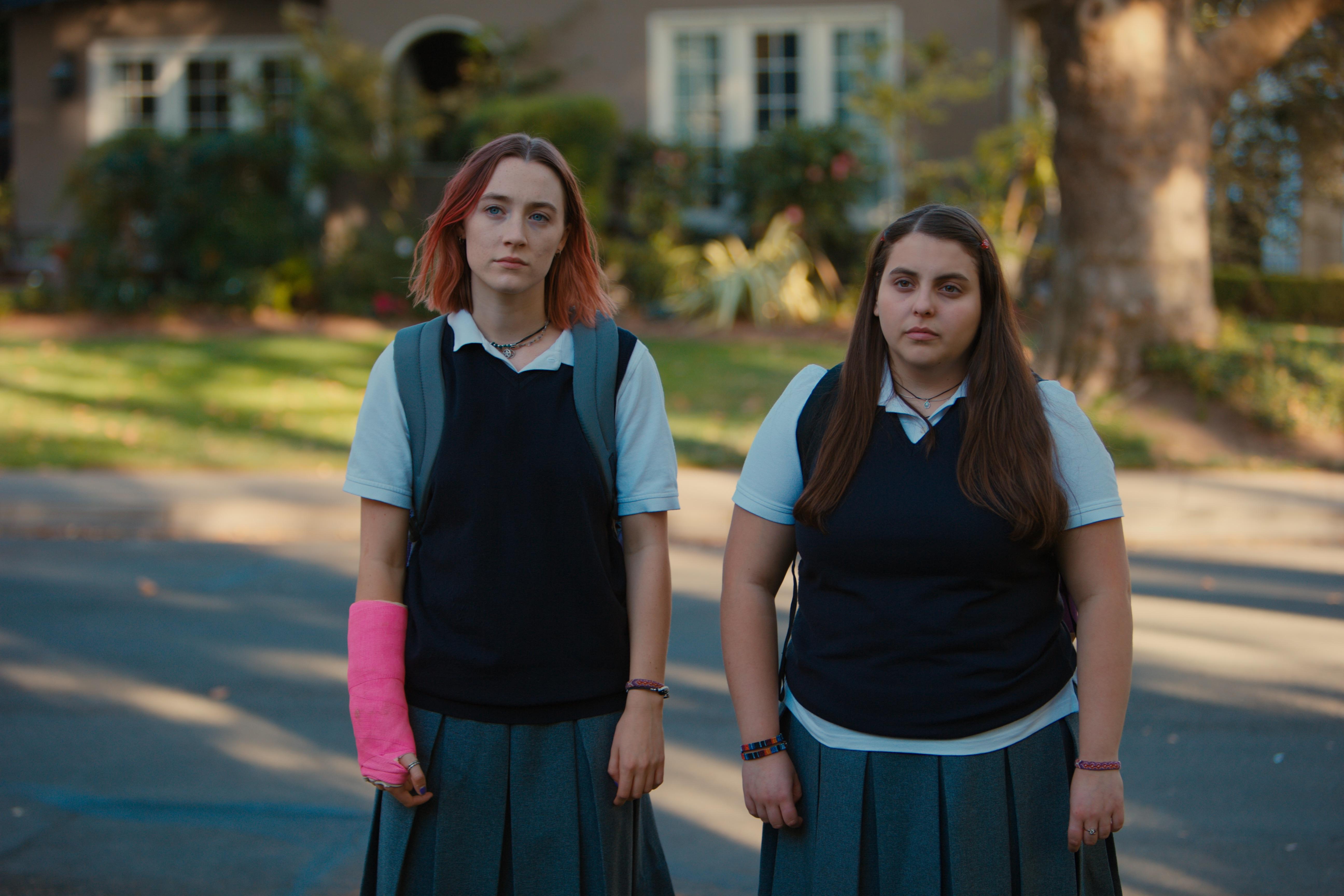"Beanie Feldstein as Julie Steffans and Saoirse Ronan as Christine ""Lady Bird"" McPherson in Lady Bird."