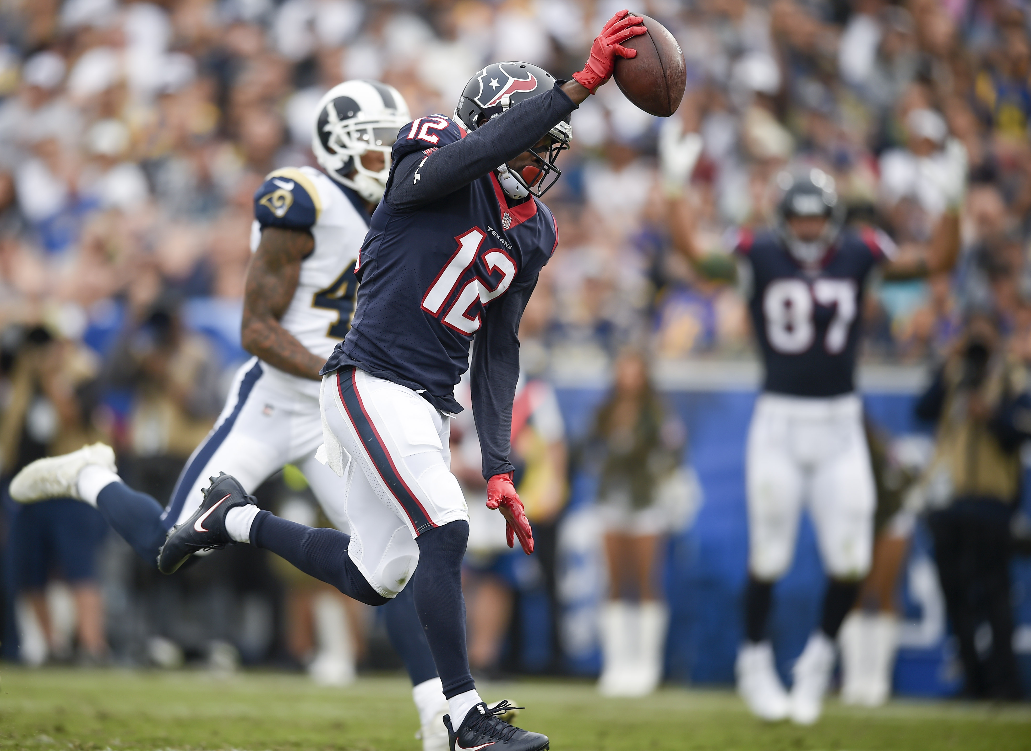 Nov 12, 2017; Los Angeles, CA, USA; Houston Texans wide receiver Bruce Ellington (12) runs in a catch for a touchdown against the Los Angeles Rams during the second quarter at Los Angeles Memorial Coliseum. Mandatory Credit: Kelvin Kuo-USA TODAY Sports