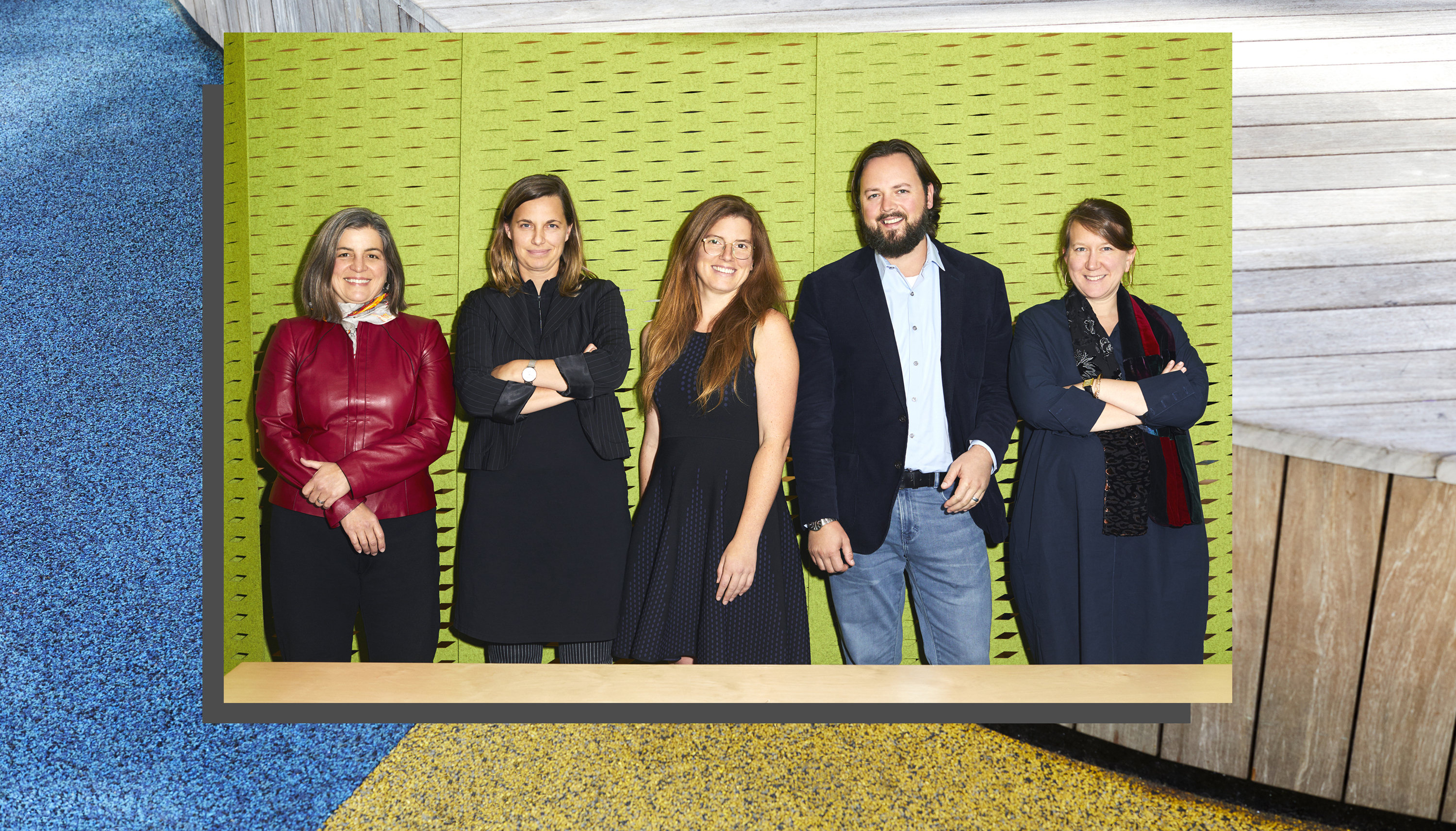 Five people—four women and one man—pose against a textured background.