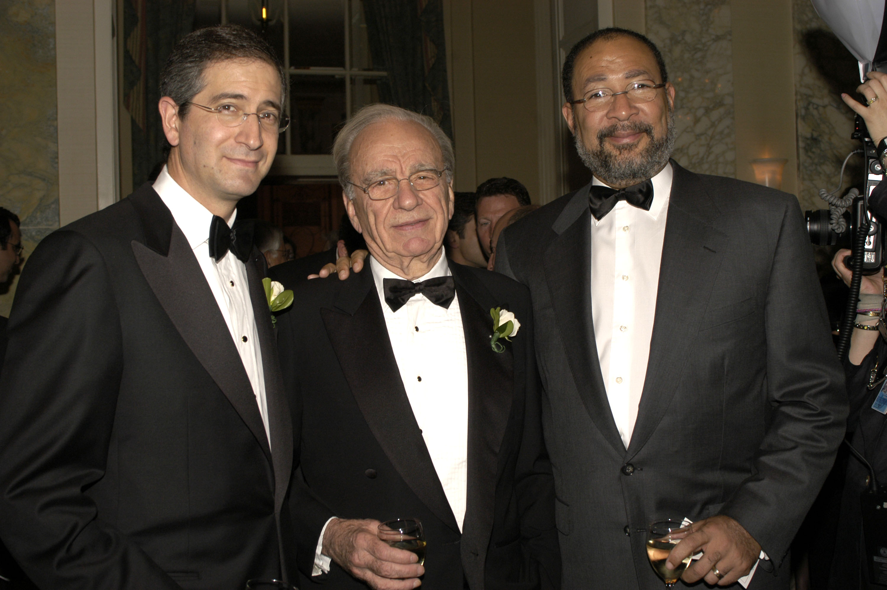 Comcast CEO Brian Roberts, 21st Century Fox exec chairman Rupert Murdoch and former Time Warner CEO Richard Parson, all wearing tuxedos