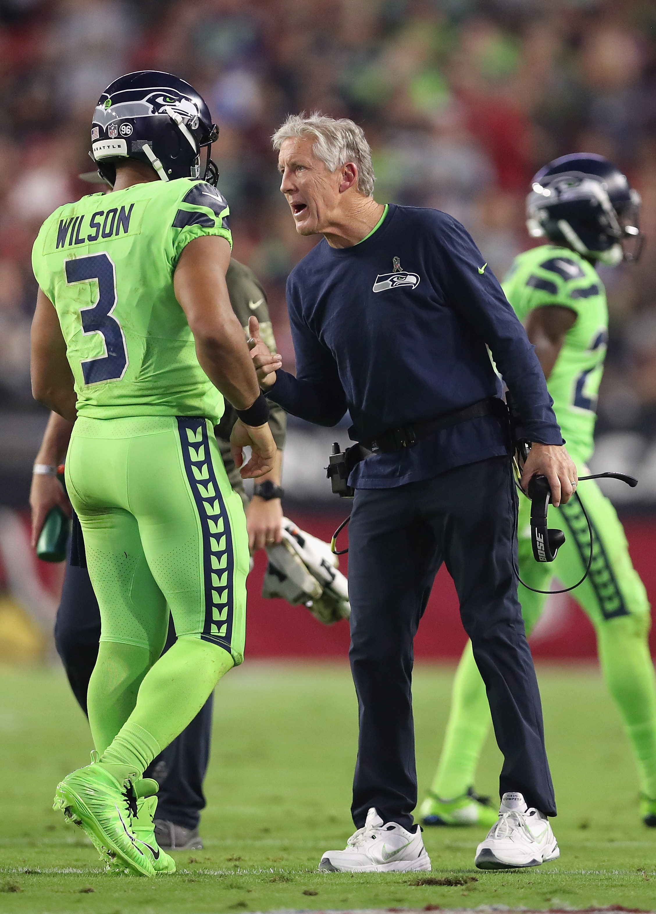 GLENDALE, AZ - NOVEMBER 09:  Head coach Pete Carroll of the Seattle Seahawks talks with quarterback Russell Wilson #3 during the first half of the NFL game against the Arizona Cardinals at the University of Phoenix Stadium on November 9, 2017 in Glendale, Arizona.  (Photo by Christian Petersen/Getty Images)