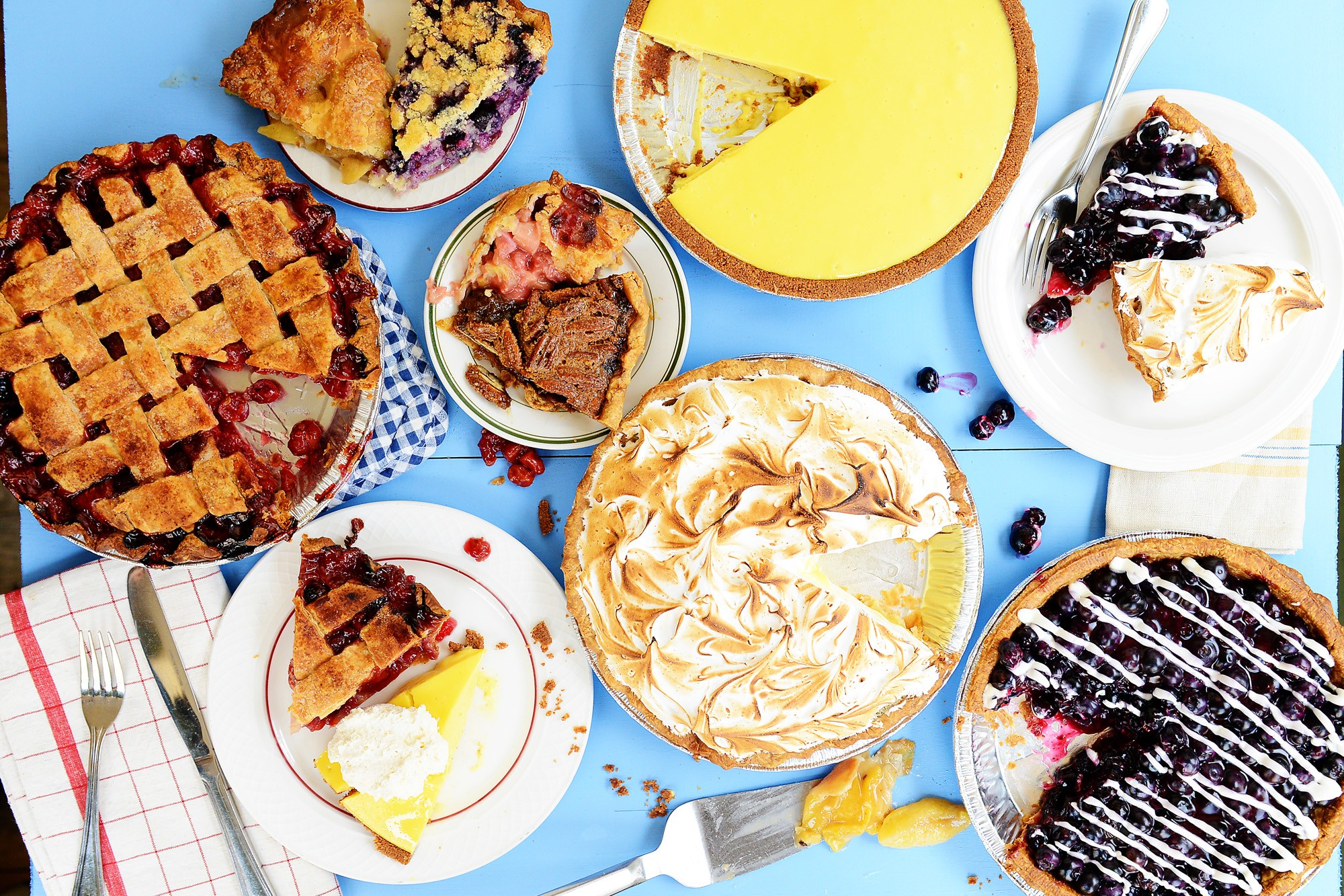 An assortment of pies on a blue background